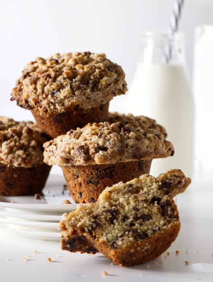 chocolate chip muffins with a bottle of milk in the background