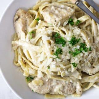 overhead shot of a bowl of garlic butter chicken pasta