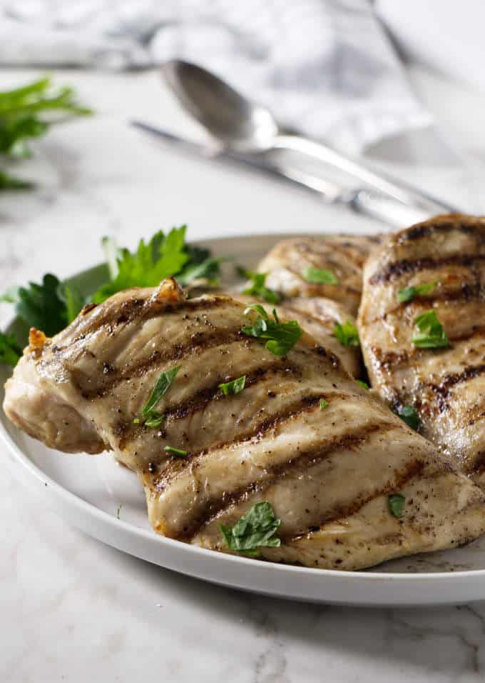 Grilled chicken breast on a serving plattter