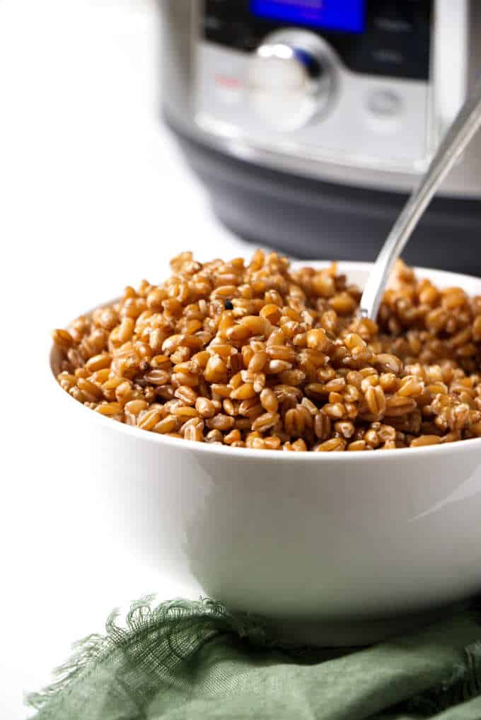 a bowl of farro with an instant pot in the background
