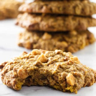 A pumpkin oatmeal cookie with a bite taken out of it