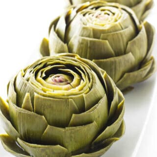 steamed artichokes on a serving platter