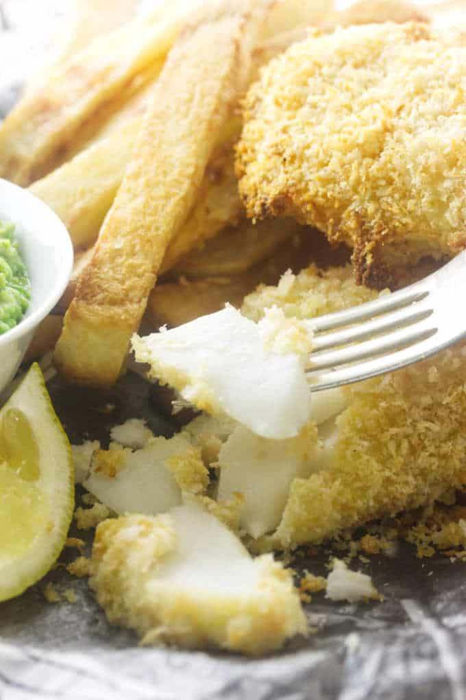 Close-up of flaky fish and crisp chips