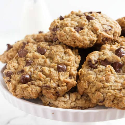 A serving plate of chocolate chip oatmeal cookies