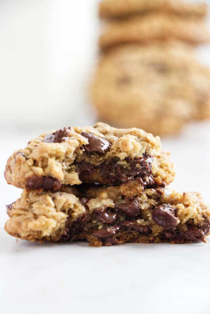Close up of a half eaten chocolate chip oatmeal cookie