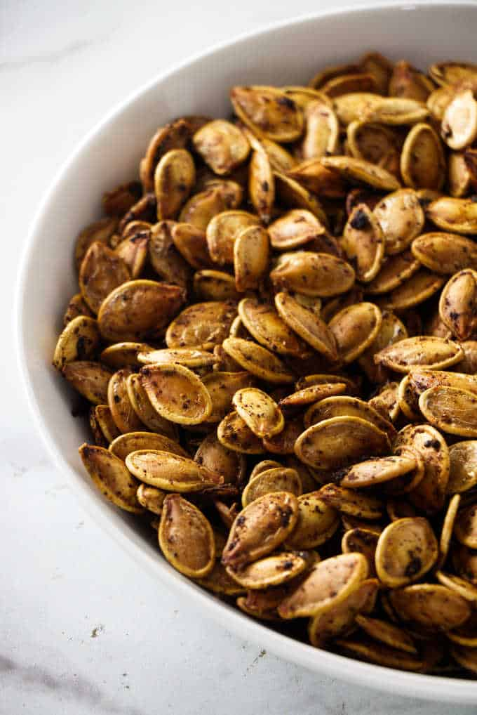 roasted pumpkin seeds in a serving bowl