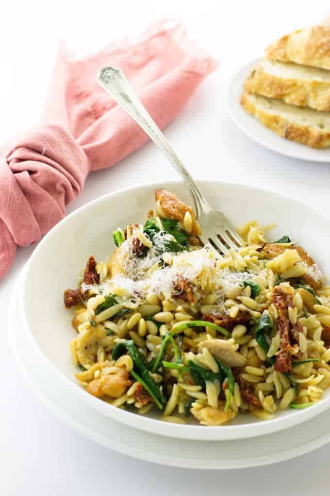 serving of chicken, orzo, sun-dried tomatoes and kale