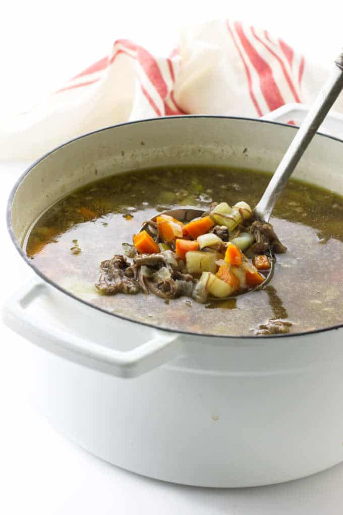 Dutch oven filled with hot oxtail soup