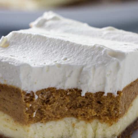 close up shot of pumpkin cheesecake layer bars
