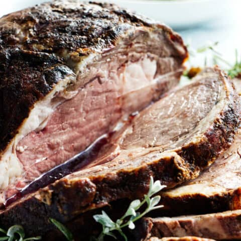Smoked prime rib with slices and juice running off