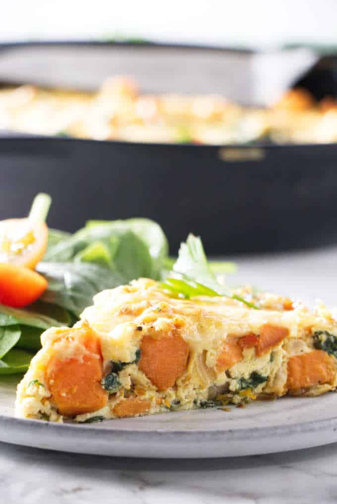 a slice of sweet potato frittata with a salad