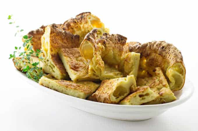 A platter of Yorkshire Pudding cut into squares