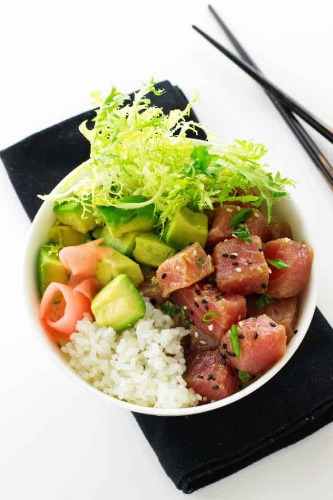 Overhead view of ahi tuna bowl on black napkin and chopsticks
