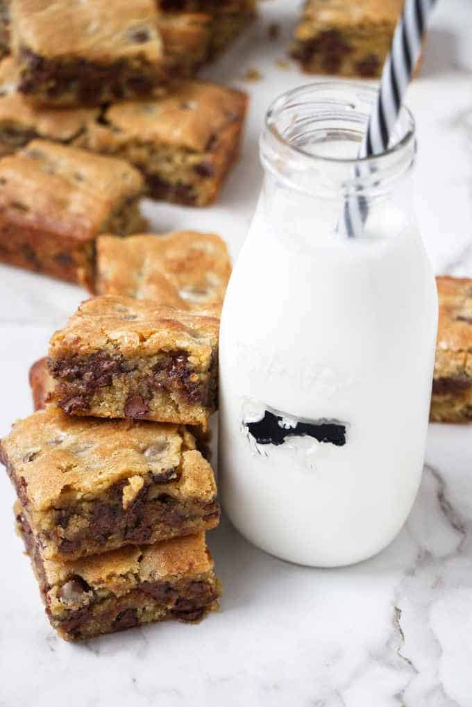 Blondie brownies next to a jar of milk