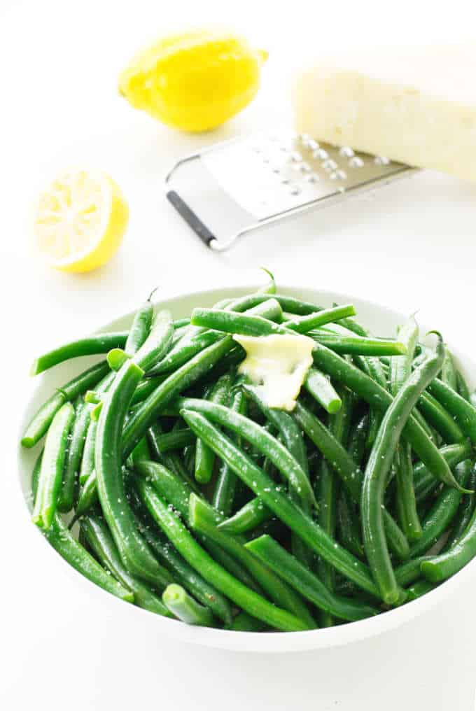 a serving dish with steamed green beans