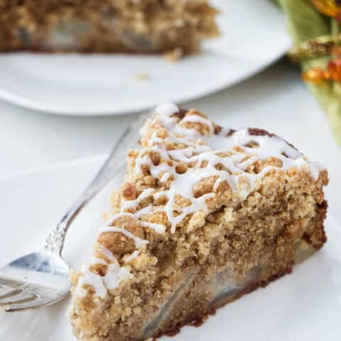 Close up photo of a slice of fresh pear cake.