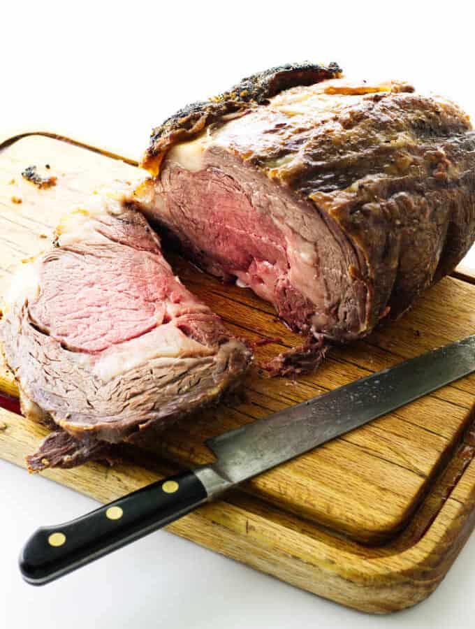 rib roast on cutting board with knife