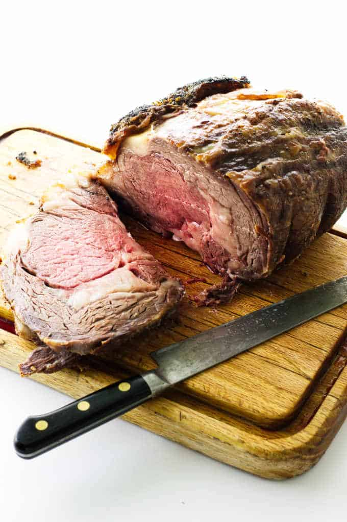 rib roast on cutting board with knife