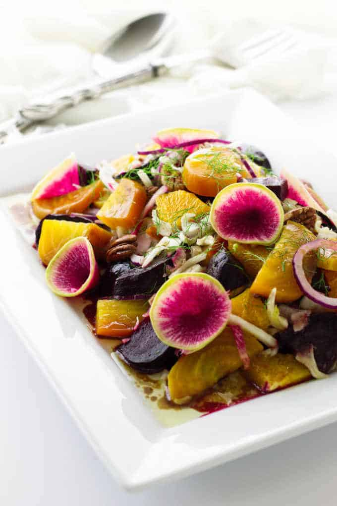 Salad of beets, fennel and watermelon radishes on platter