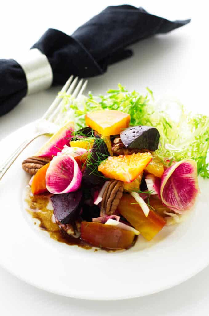 Overhead view of salad on a plate with napkin in the background
