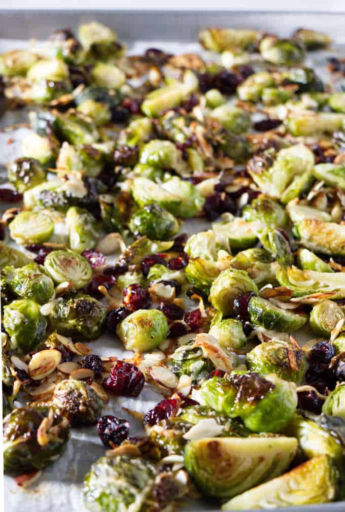 A sheet pan of roasted Brussels sprouts with parmesan, cranberries, and almonds