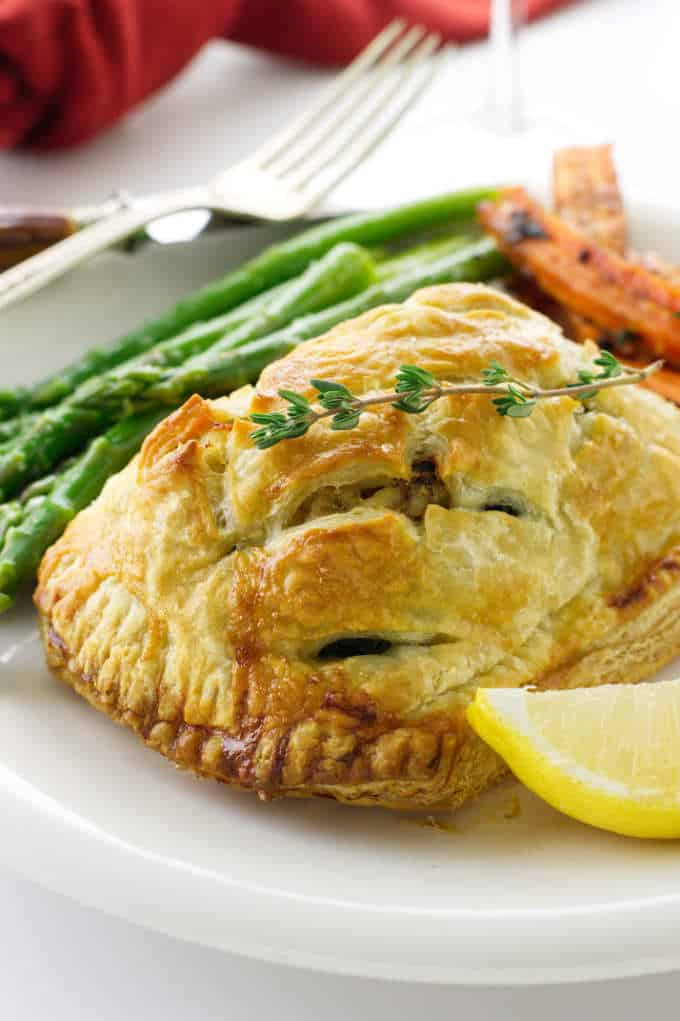Close up of a serving of salmon and crab wellington
