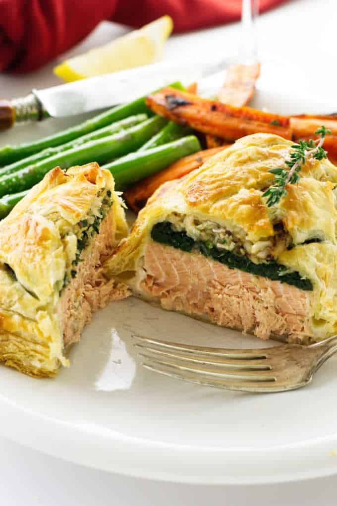 Close up serving of salmon and crab wellington