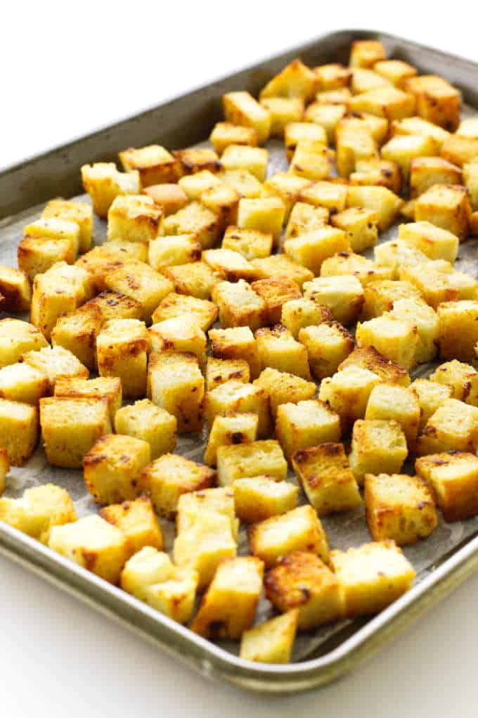 Baking sheet of golden brown garlic croutons