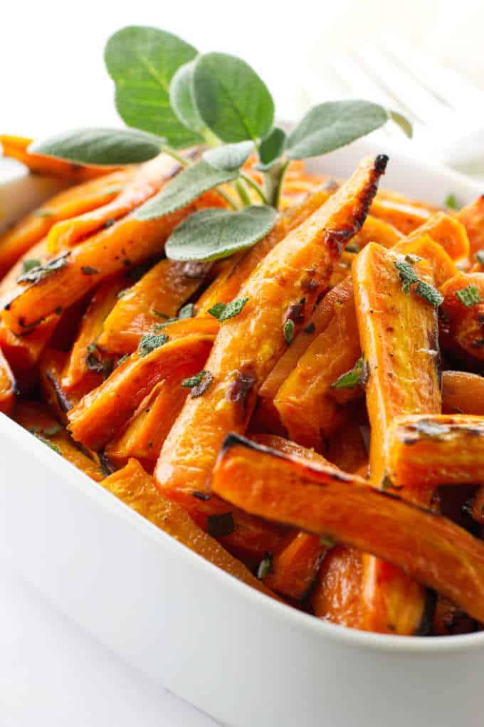 Dish of honey roasted carrots with sage