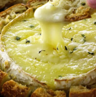 Toasty garlic bread dipped in melted brie