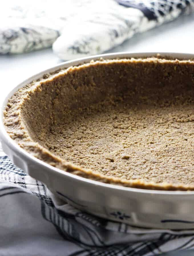 Brown sugar pecan pie crust in a pie plate.