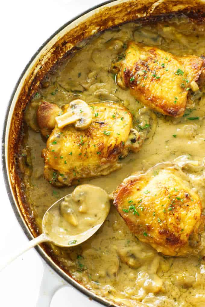 Close up view of chicken thighs in mushroom cream sauce