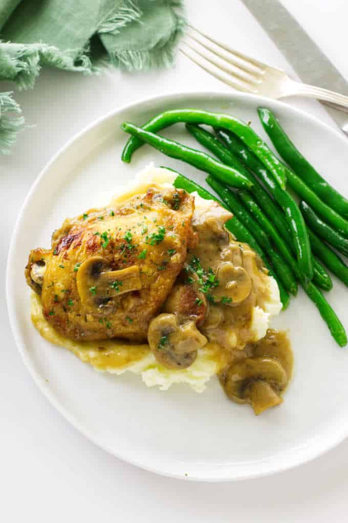 Overhead view of chicken and mushroom cream sauce on top of mashed potatoes