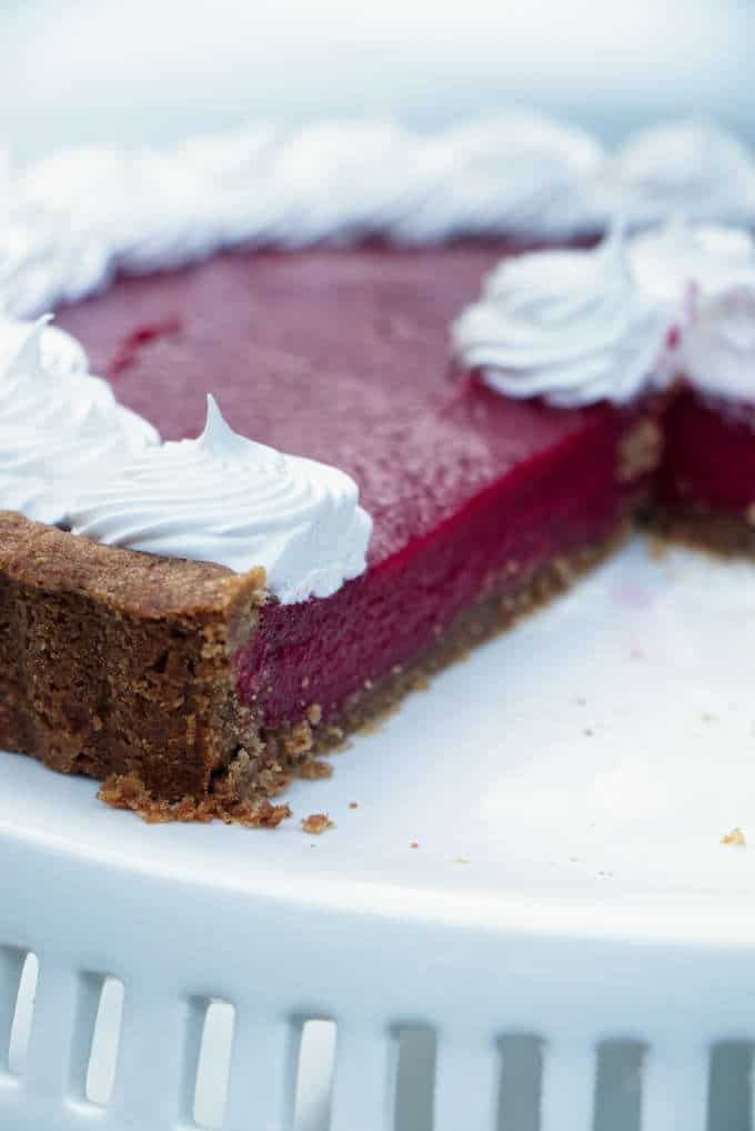 Cranberry curd tart on a cake plate