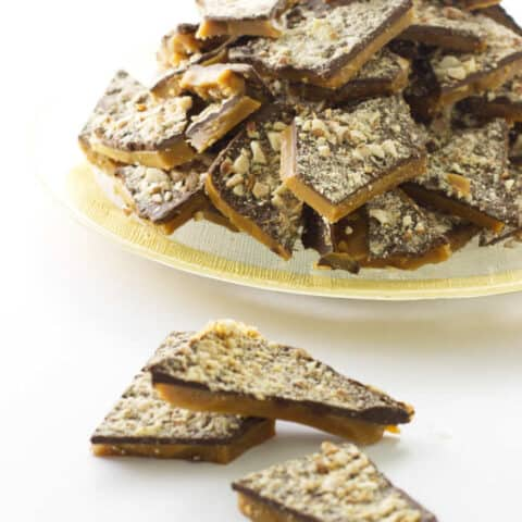 Plate of English toffee with 3 pieces in foreground