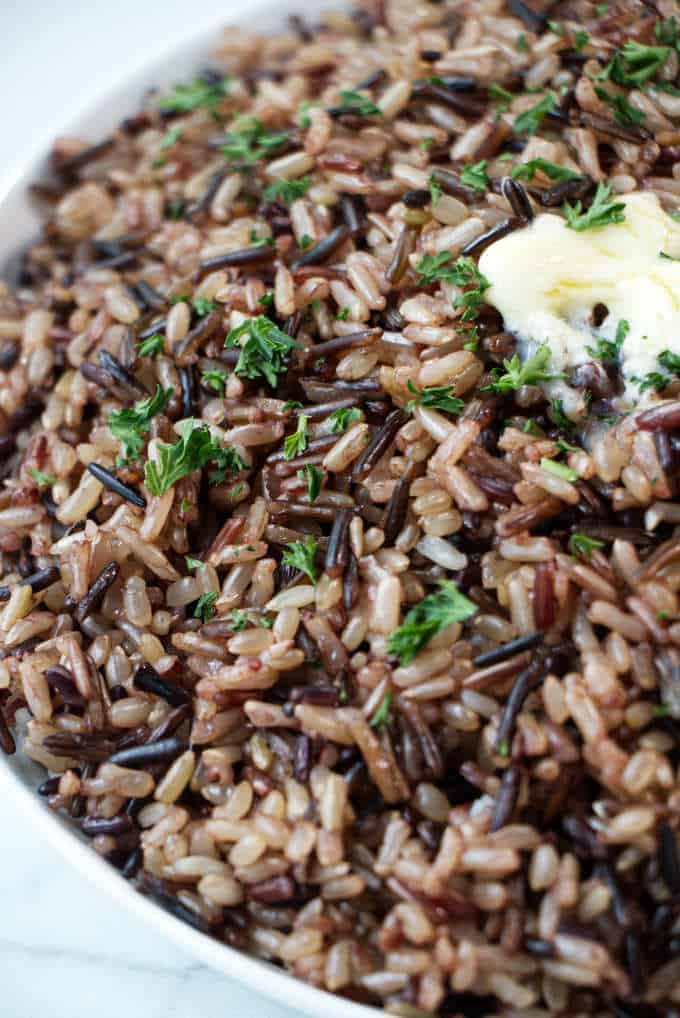 Closeup of wild blend rice with a pat of butter on top.