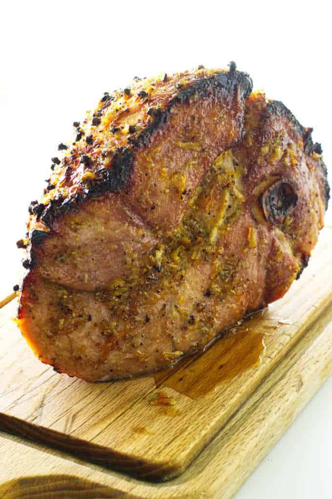 Baked ham on cutting board