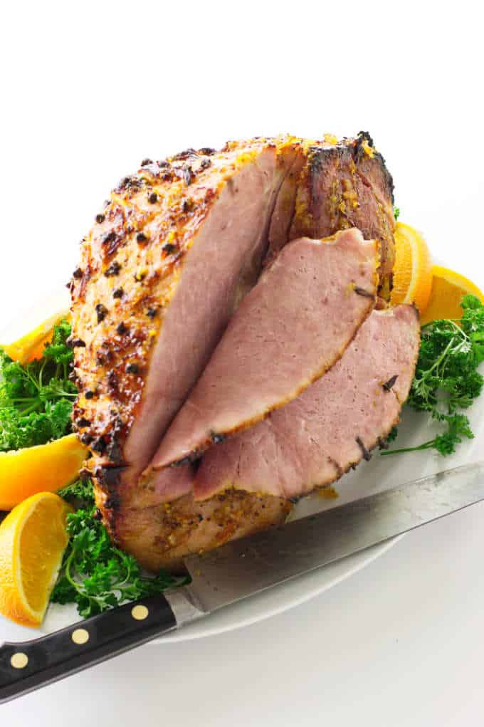 Clove studded baked ham with two slices cut