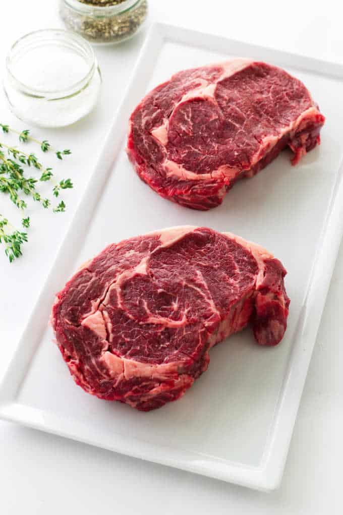 2 uncooked ribeye steaks