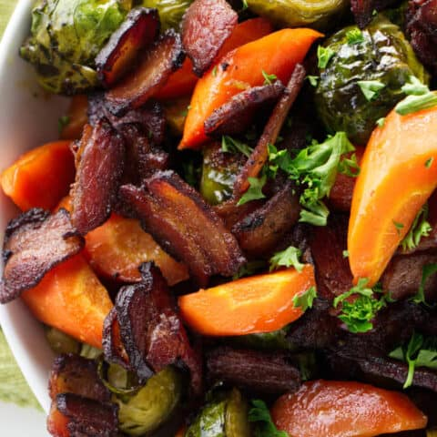 roasted brussel sprouts and carrots in a serving bowl.