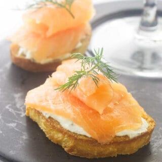 close up view of 2 pieces of smoked salmon crostini