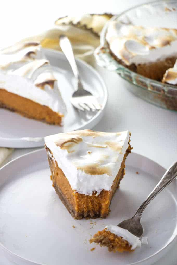 Two slices of Southern sweet potato pie next to a pie plate.