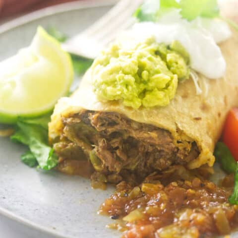 A close up photo of a shredded beef chimichanga.