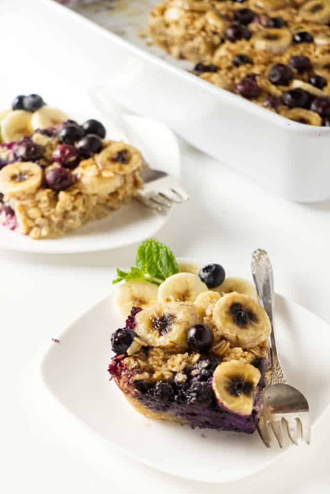 Two serving plates with slices of baked oatmeal.