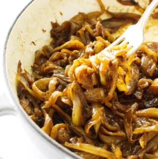A fork picking up some caramelized onions.