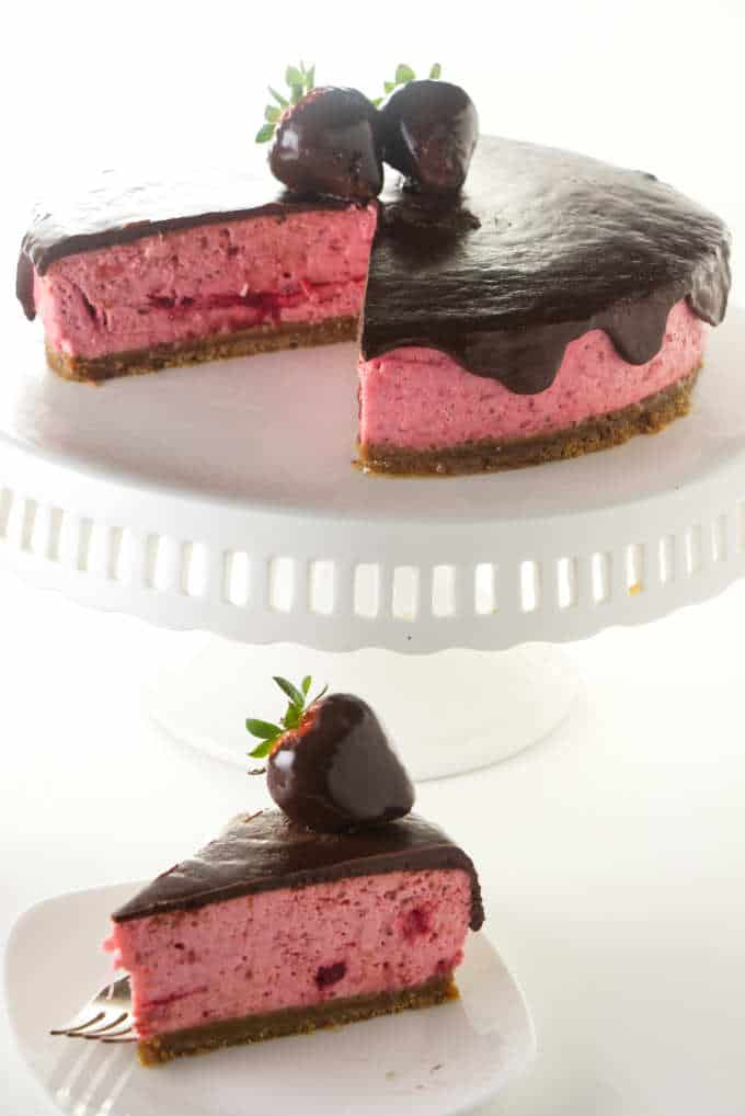A chocolate covered strawberry cheesecake with chocolate covered strawberries on top.