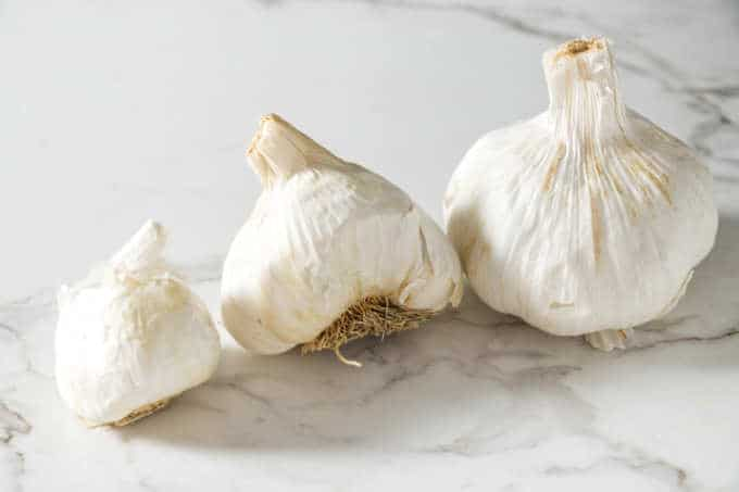 three sizes of garlic