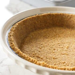 Graham cracker crust in a pie plate.