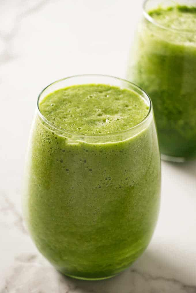 A glass filled with a green power smoothie.