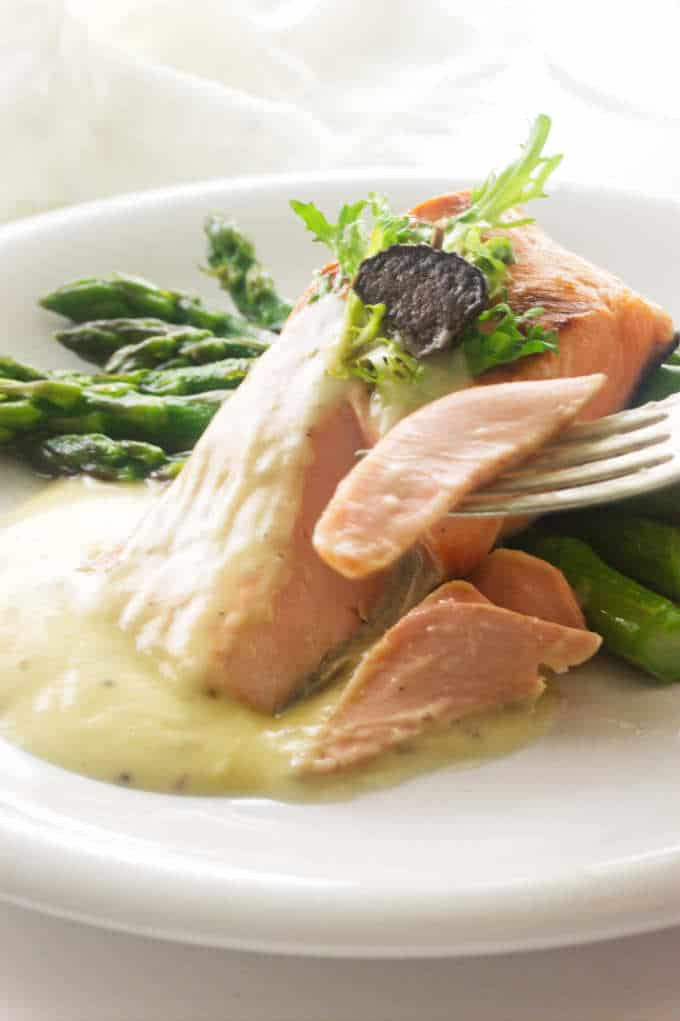 asparagus, salmon and Beurre Blanc sauce, salmon bite on fork